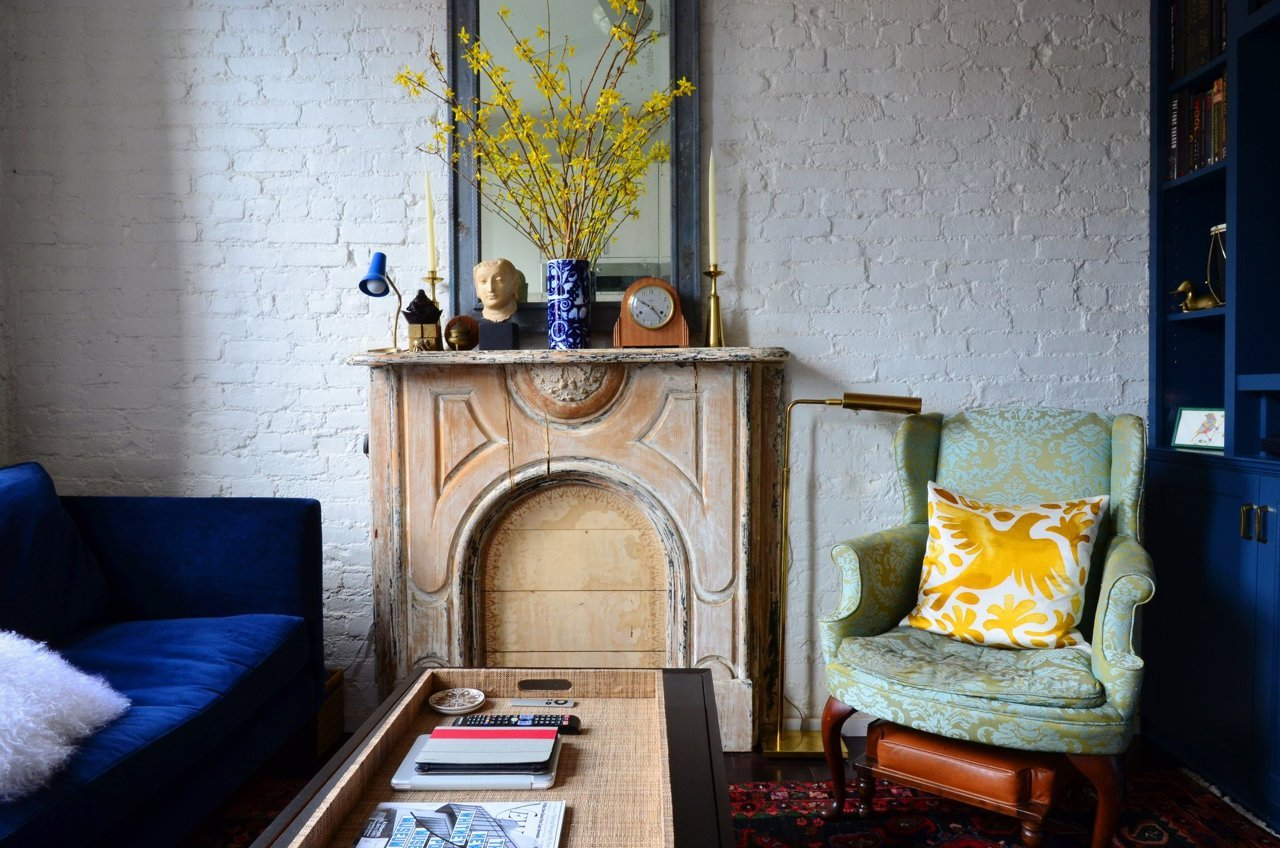 rustic wood fireplace small nyc apartment
